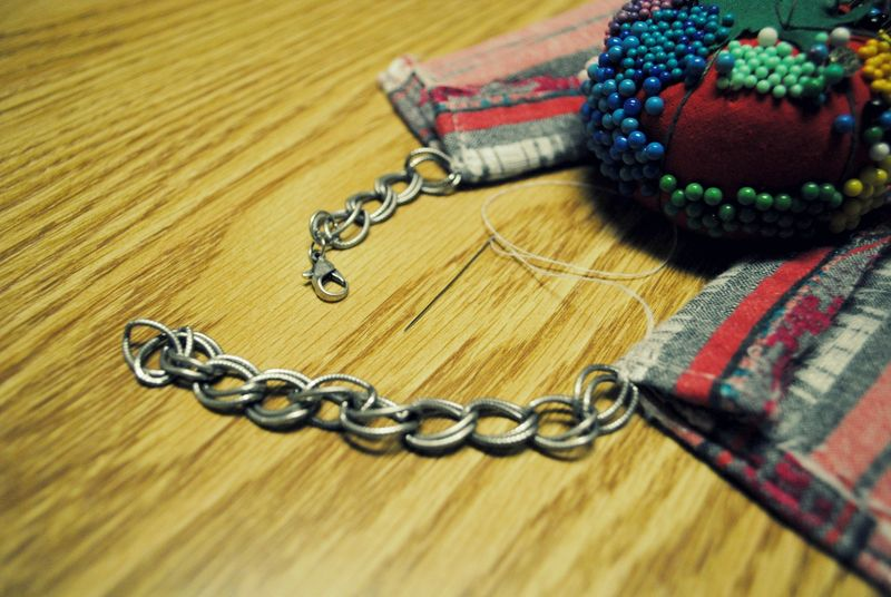 Sew each end of the bracelet on the back ends of the collar
